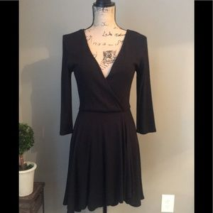 Black skater style faux wrap knit dress